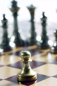 Pawn surrounded by superior chess pieces